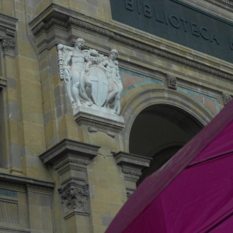 Umbrella and moulding of the national library in Florence. Walking in the rain.
