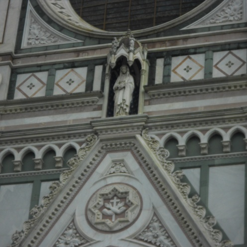 Basilica Di Santa Croce on top of the doorway in Florence