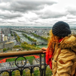 My standing on Eiffel Tower looking at Paris