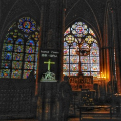 Stain glass windows inside of Notre Dame Cathedral in Paris
