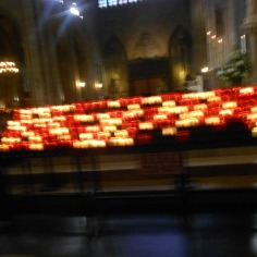 The candles inside of Notre Dame Cathedral Paris