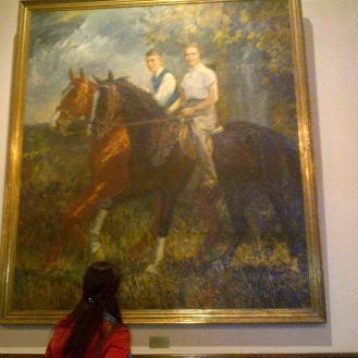 Maria looking at a painting inside of Villa Hugel