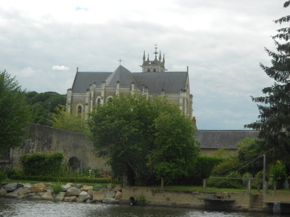 Church along the riverside in Laval, France