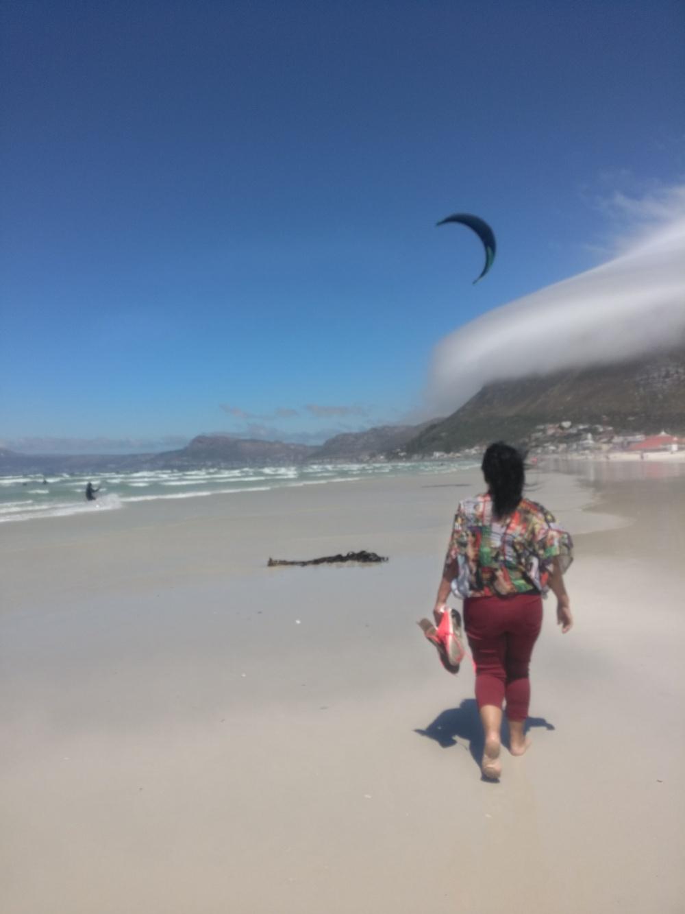 My mom walking at Muizenberg beach