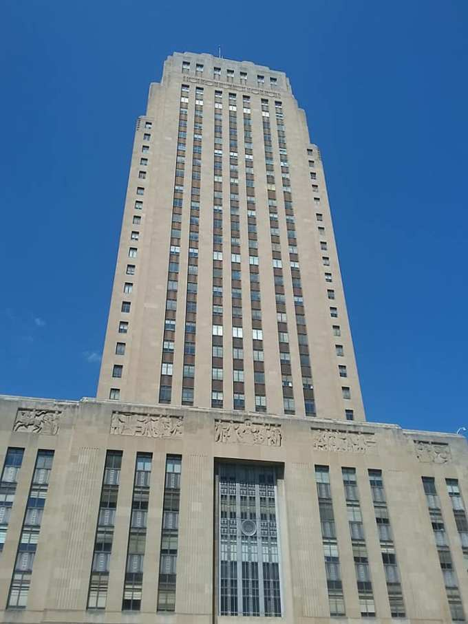 The building was designed in the art deco style that was popular in the 1930s. The building interior is also lovely with a lot of brass fixtures and panoramic friezes.