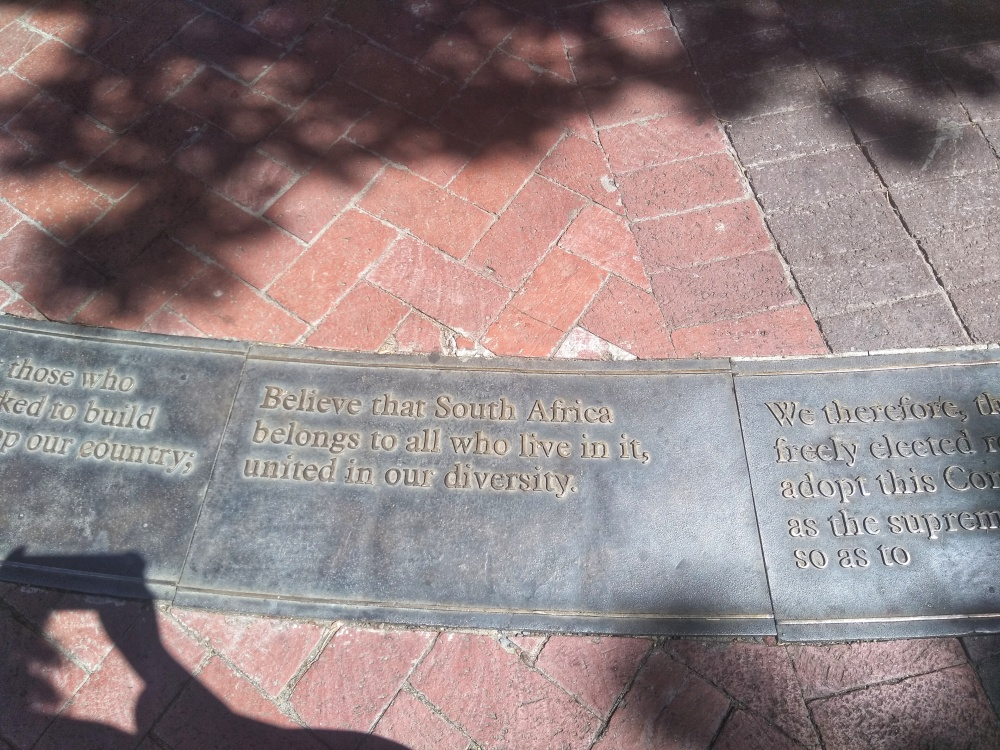 In front of the Company Gardens of Cape Town are the opening lines of South Africa's Constitution