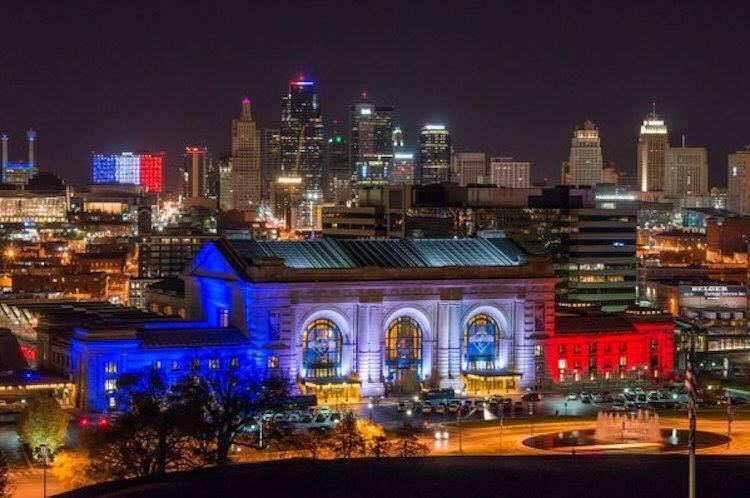 Honoring the 100th anniversary of the end of World War I, Union Station (foreground) and all of KC is lit up in the tri-colors of the French Flag.[