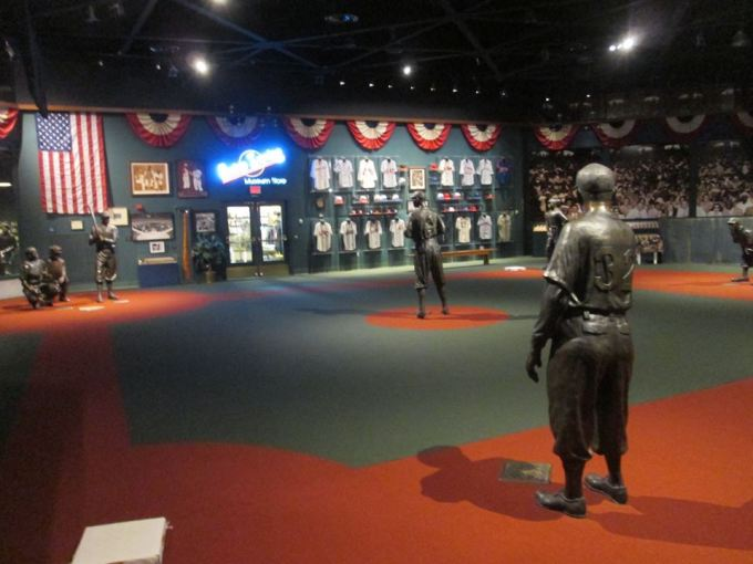 The Museum features a life-size baseball diamond and statues of some of the League's best players in each position