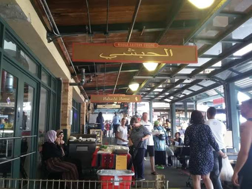 People from all over the world converge on the City Market. It is one of the best places in all of KC to people watch.